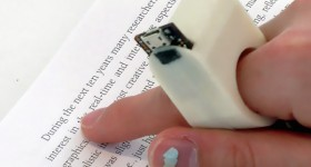 FingerReader ring in use