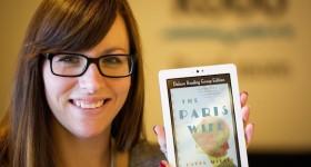 woman holding an e-reader
